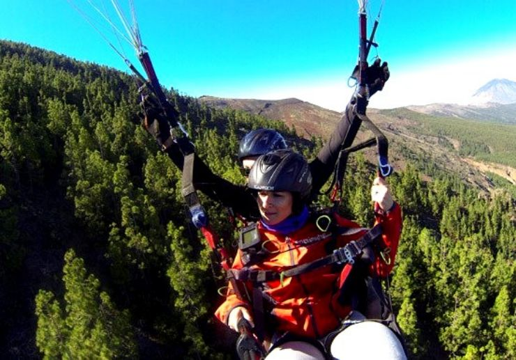 Paragliding over lush pines of Tenerife