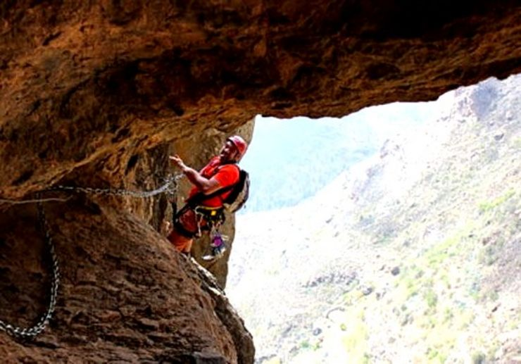 Ferrata climbing in Gran Canaria using chains and stemples