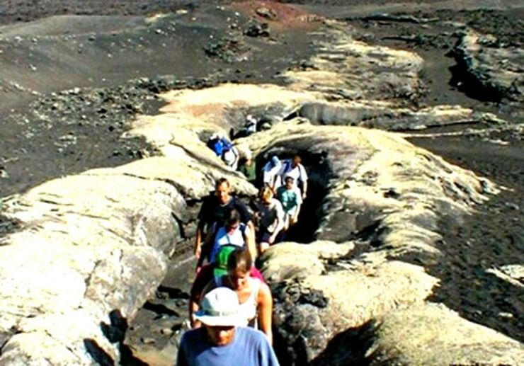 Hiking volcanic rock formation in Lanzarote