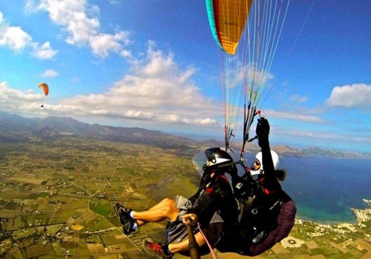 Tandem paragliding over Mallorca coastline