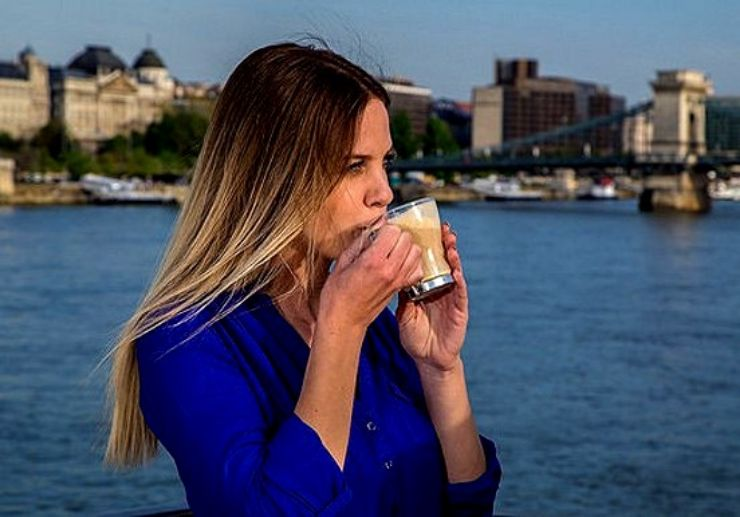 Drink coffee while cruising on Danube river in Budapest