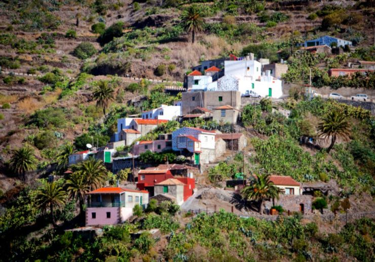 Houses on the green slope of Masca gorge in Tenerife